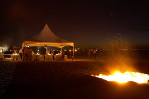 beach wedding with bonfire and tent