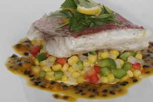 grilled fish served on corn salsa with passion fruit sauce